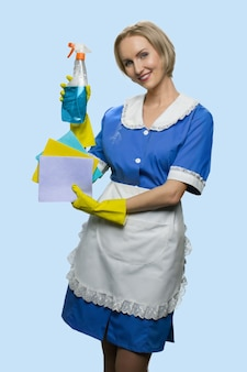 Mature woman holding detergent and cleaning rags