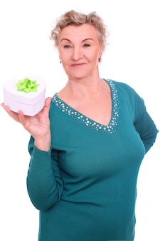 Mature woman holding a present