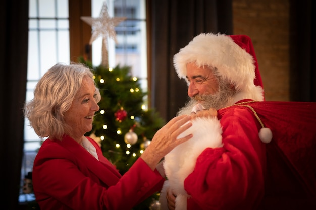 Mature woman setting up santa claus