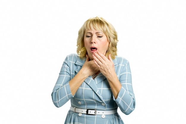 Mature woman suffering from coughing. middle aged woman in bad condition coughing and having flu isolated on white.