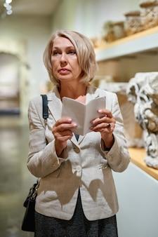 Mature woman visiting art museum