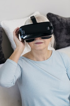 Mature woman in vr headset on couch