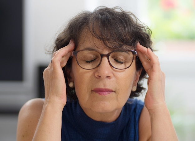 Mature woman with a headache