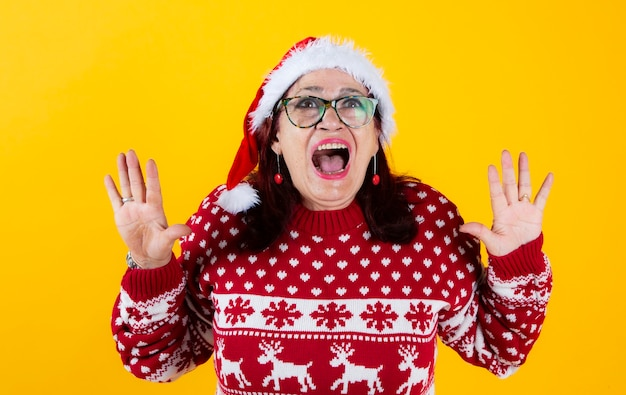 Mature woman with santa claus hat