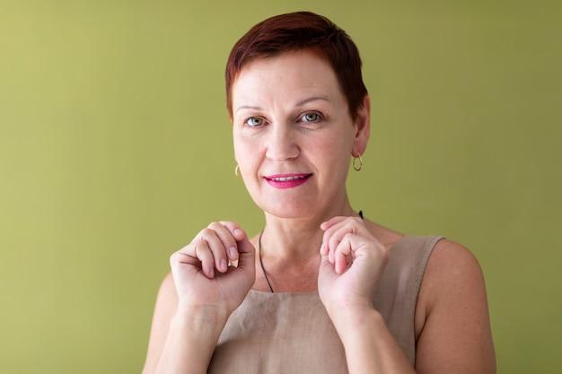 Mature woman with short hair looking at camera