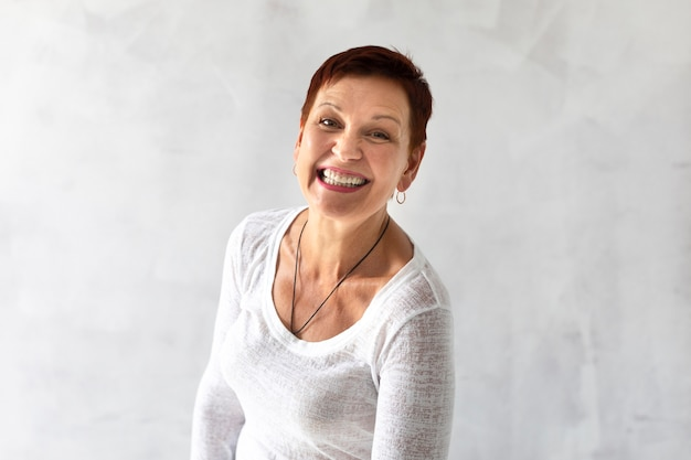 Mature woman with short hair smiling