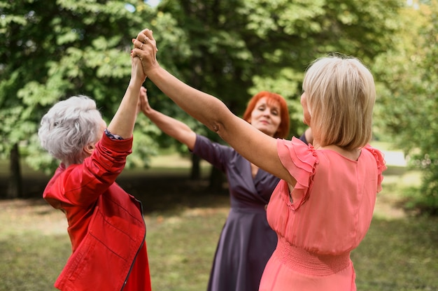Mature women playing together in the park