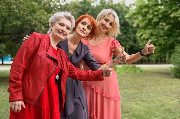 Mature women together in the park