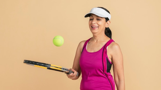 Matured female indian tennis player ready to play