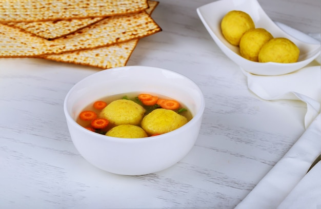 Matzah balls, jewish soup dumpling made from on passover jewish holiday kosher food background