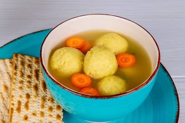 Matzah balls in a pot of soup during the jewish holiday of passover