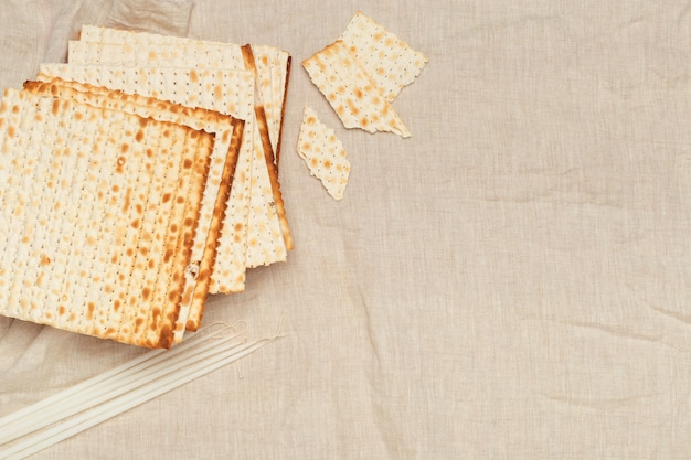 Matzo, matzoth for jewish passover, wooden  close up