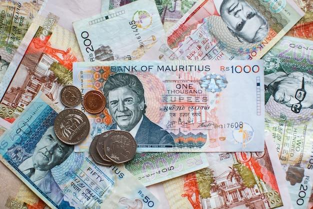 Mauritius money mauritius rupeenotes and coins close up