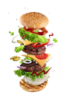Maxi hamburger, double cheeseburger with flying ingredients isolated on white