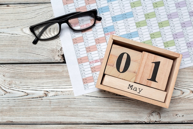 May 1 wooden surface color calendar on wooden surface
