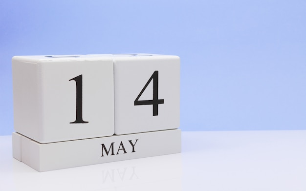May 14st. day 14 of month, daily calendar on white table