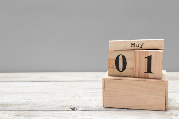 May 1st. image of may 1 wooden color calendar on wooden table. spring day, empty space for text. international workers' day