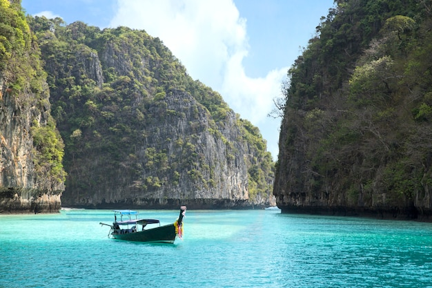 Maya bay in andaman sea and wooden boat with mountain view in phuket thailand