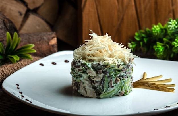 Mayonnaise salad topped with grated cheese