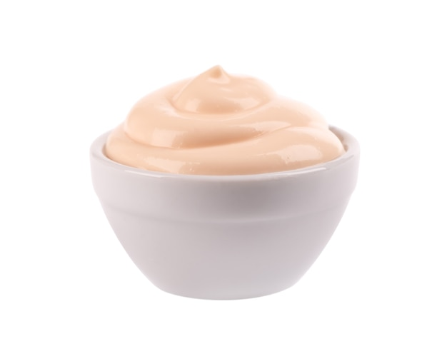 Mayonnaise sauce in bowl, isolated  creamy salad dressing.