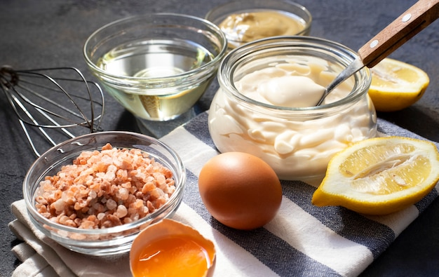 Mayonnaise sauce and ingredients for fresh homemade mayonnaise
