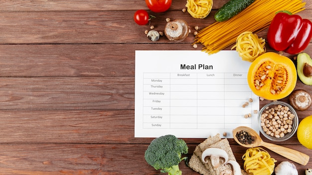 Meal plan with copy space and lots of vegetables and pasta