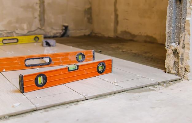 Measure tile repair in the house. selective focus.