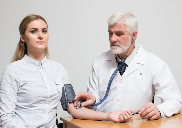 Measuring arm smile two closeup stethoscope