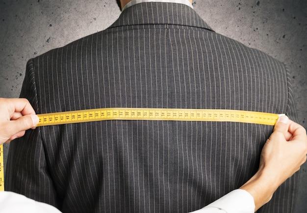 Measuring back of jacket on background