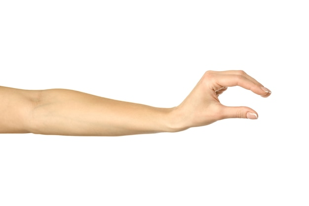 Measuring invisible item. woman hand with french manicure gesturing isolated on white wall. part of series