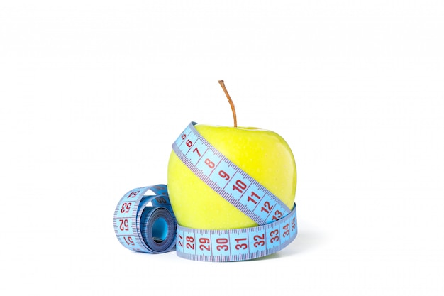 Measuring tape and apple isolated on white