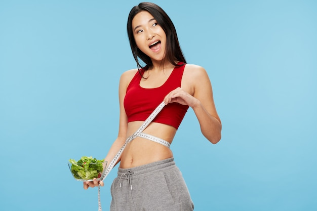 Measuring tape figure healthy eating lifestyle eating woman of asian appearance