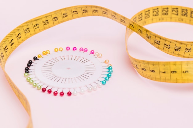Measuring tape with colorful needles
