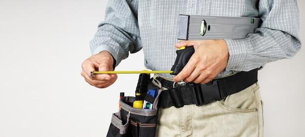 Measuring tools in builders hands
