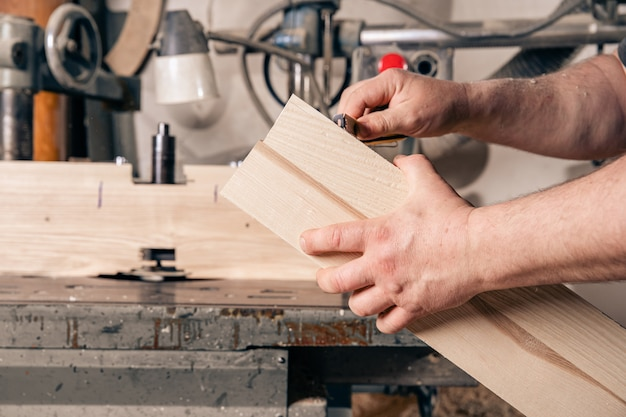 Measuring wood before processing in joinery