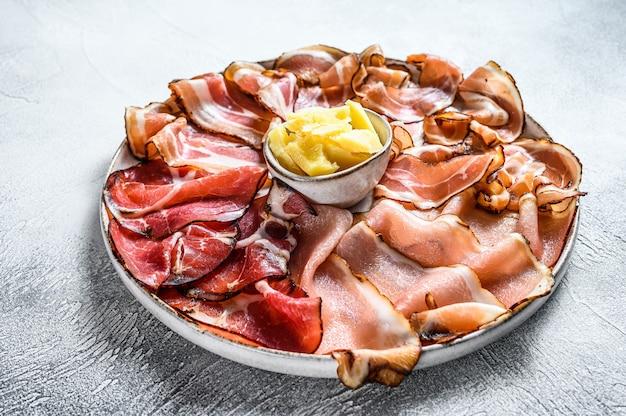 Meat antipasto platter, pancetta, salami, sliced ham, sausage, prosciutto, bacon