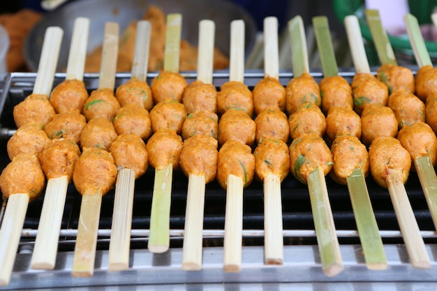 Meat balls on grill.