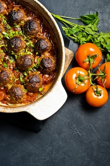 Meat balls in tomato sauce in a baking dish.