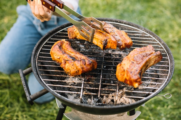 Meat on barbecue grill in nature