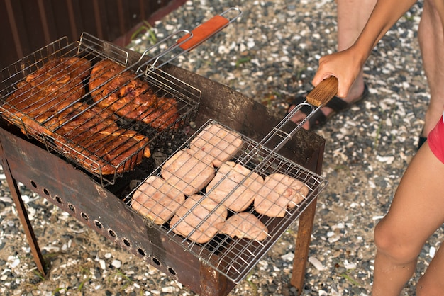 Meat barbecue on a summer evening camping