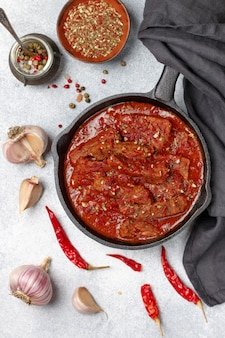 Meat (beef) stewed in tomato sauce . goulash