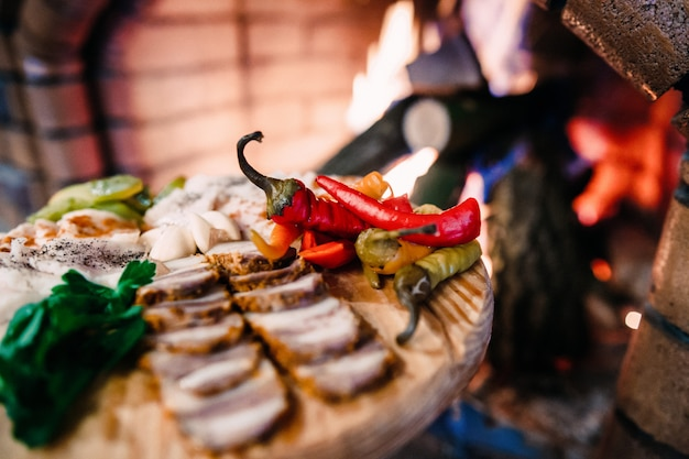 Meat board with ukrainian lard, pepper and vegetables