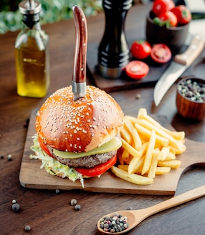 Meat burger with vegetables and french fries