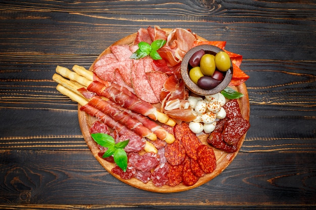 Meat and cheese plate with salami sausage, chorizo, parma and mozzarella