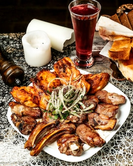 Meat and chicken kebab sprinkled with sumac and onion