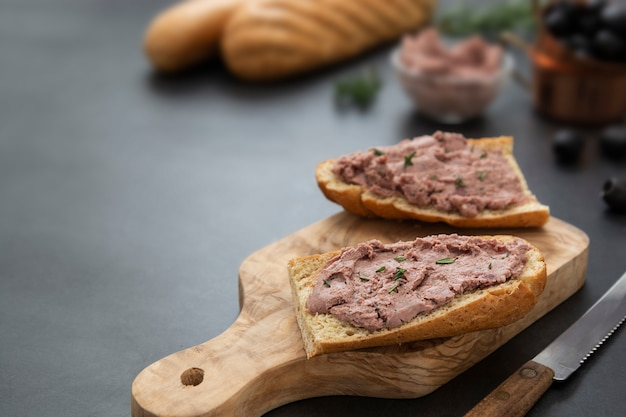 Meat chicken or pork liver pate sandwich over whole grain bread slices
