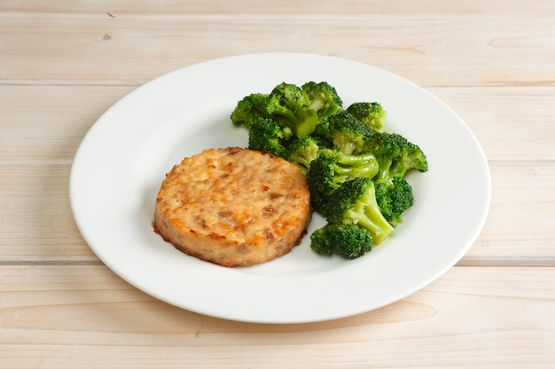 Meat cutlet with cheese and broccoli