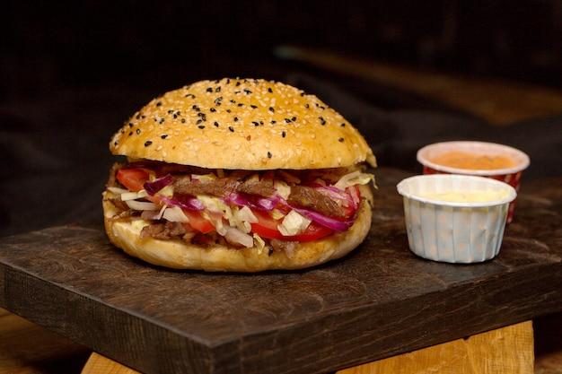 Meat doner in bread on a wooden board