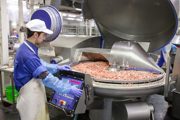 The meat in the grinder. the meat industry.