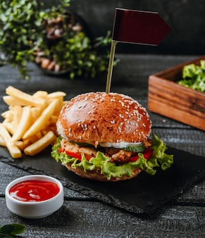 Meat hamburger with vegetables and french fries
